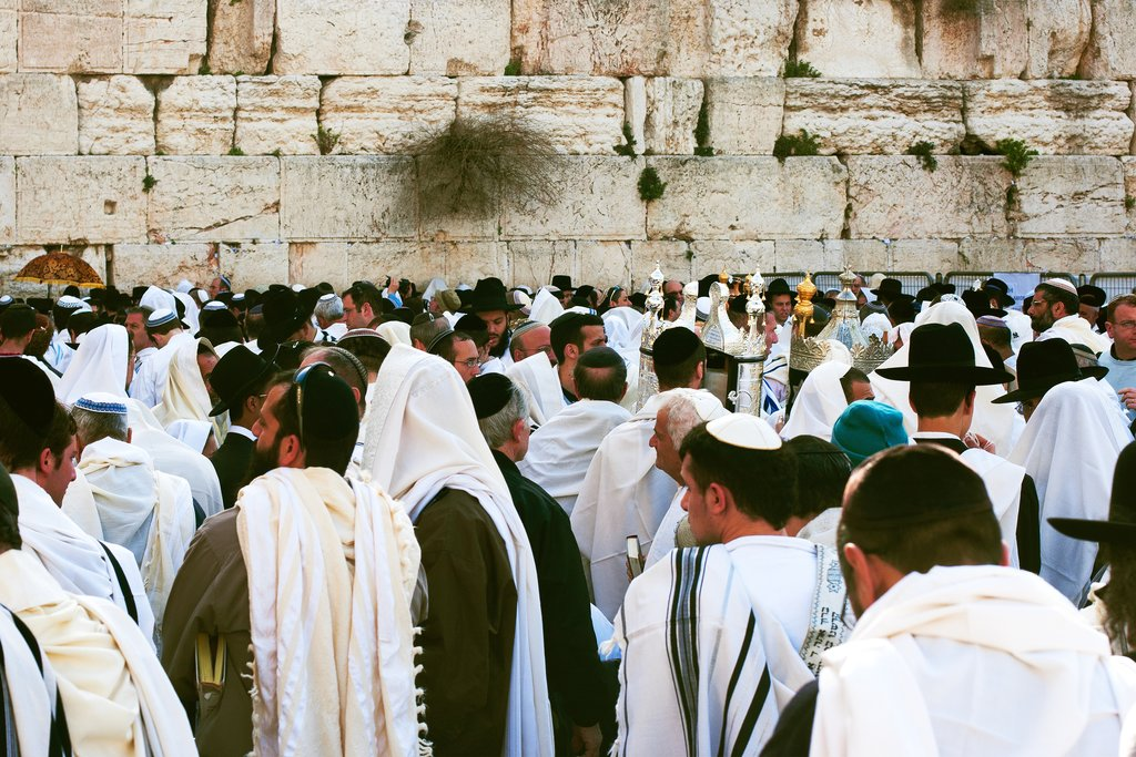 Men praying by the Western Wall