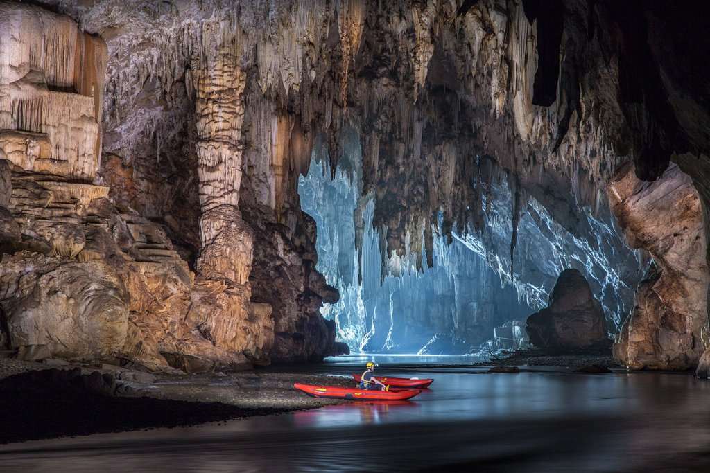 Explore Tam Lod cave system by boat or bamboo raft