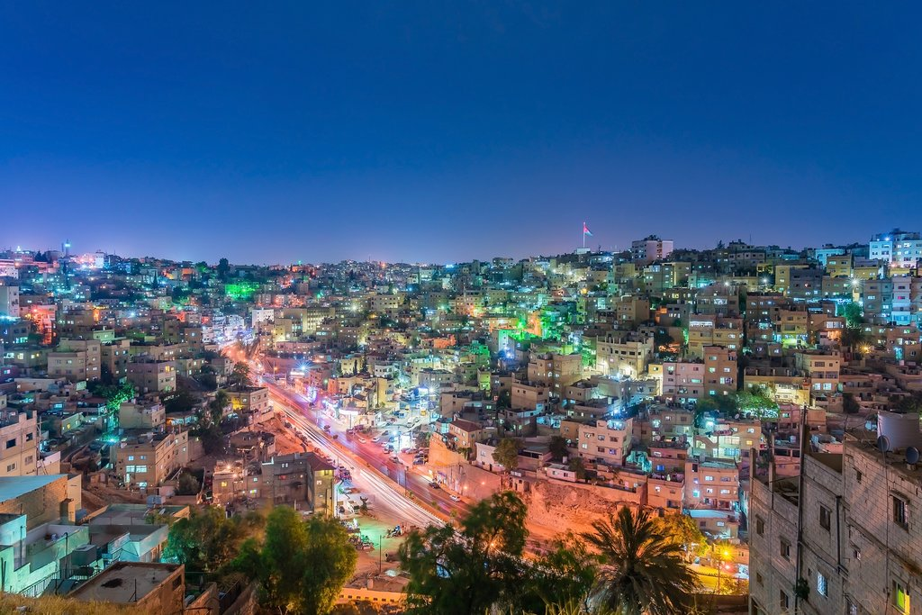 A view of Amman's city lights at dusk