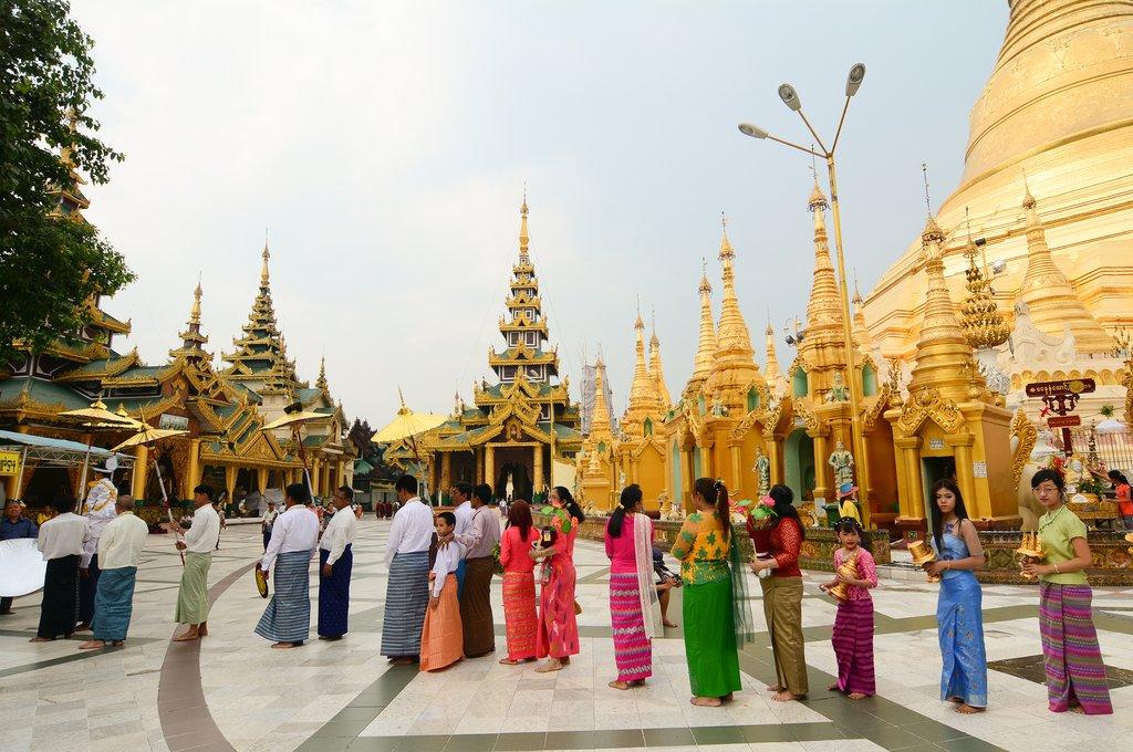 People praying at Shwedagon Pagoda in Yangon, Myanmar