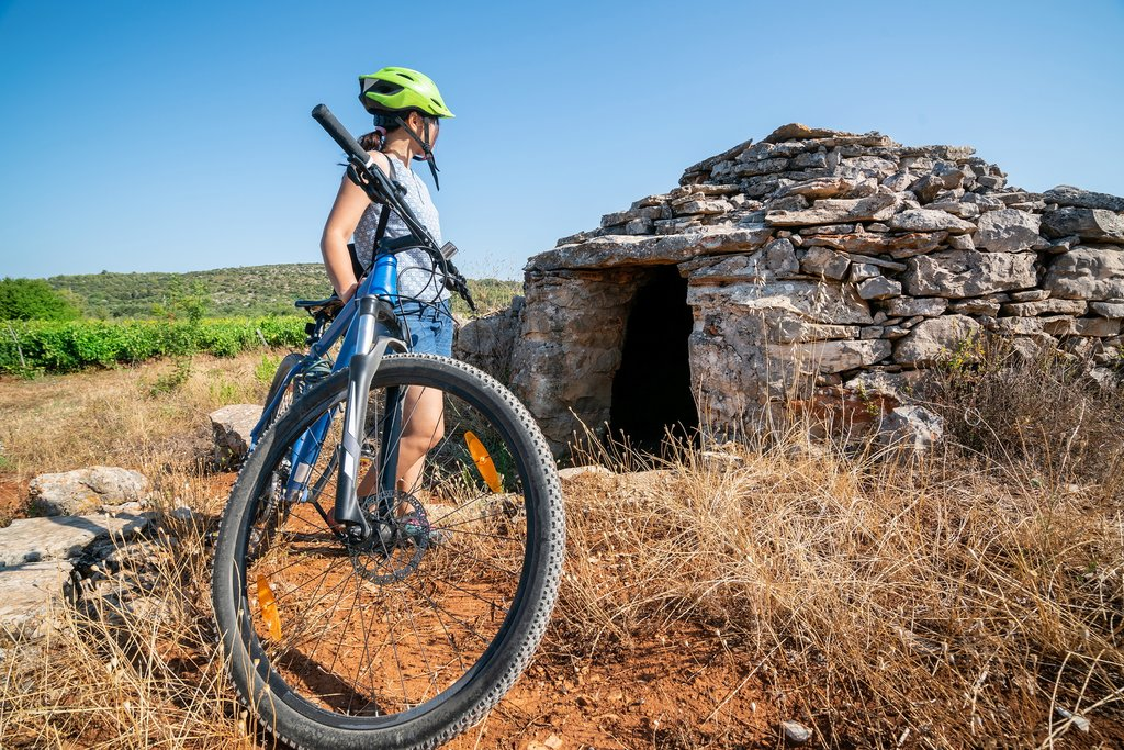 Croatia - Hvar - Cyclist explore plains around Stari Grad