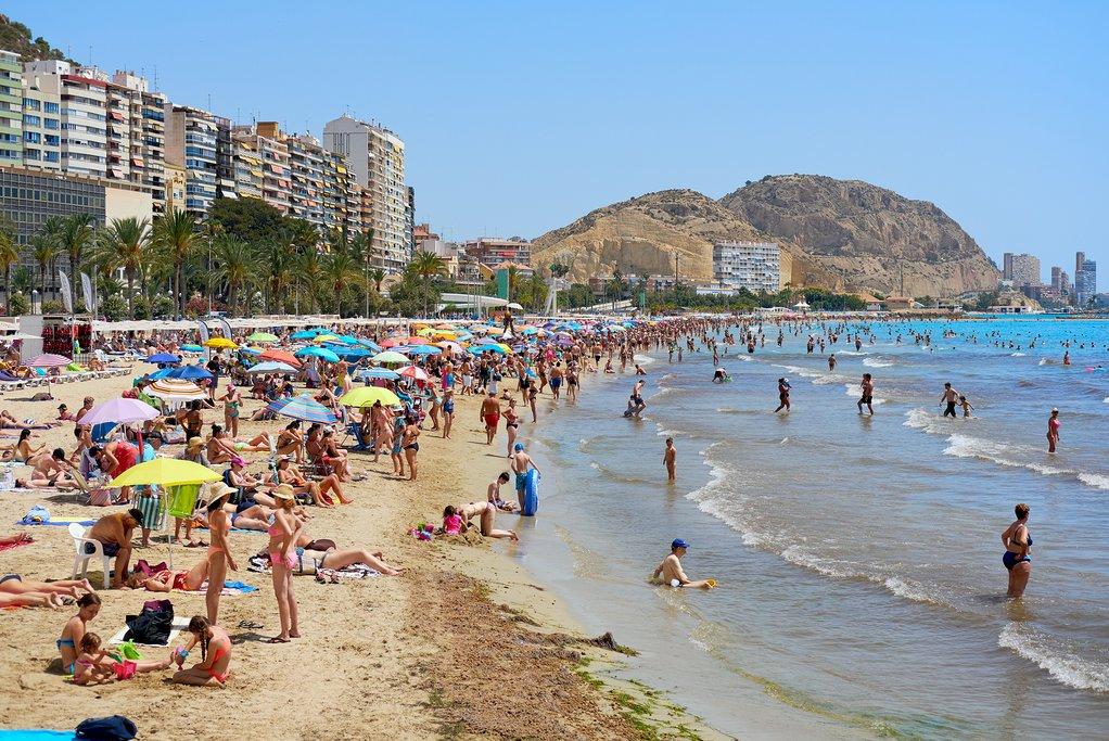 Sunbathing on Alicante's Postiguet Beach.