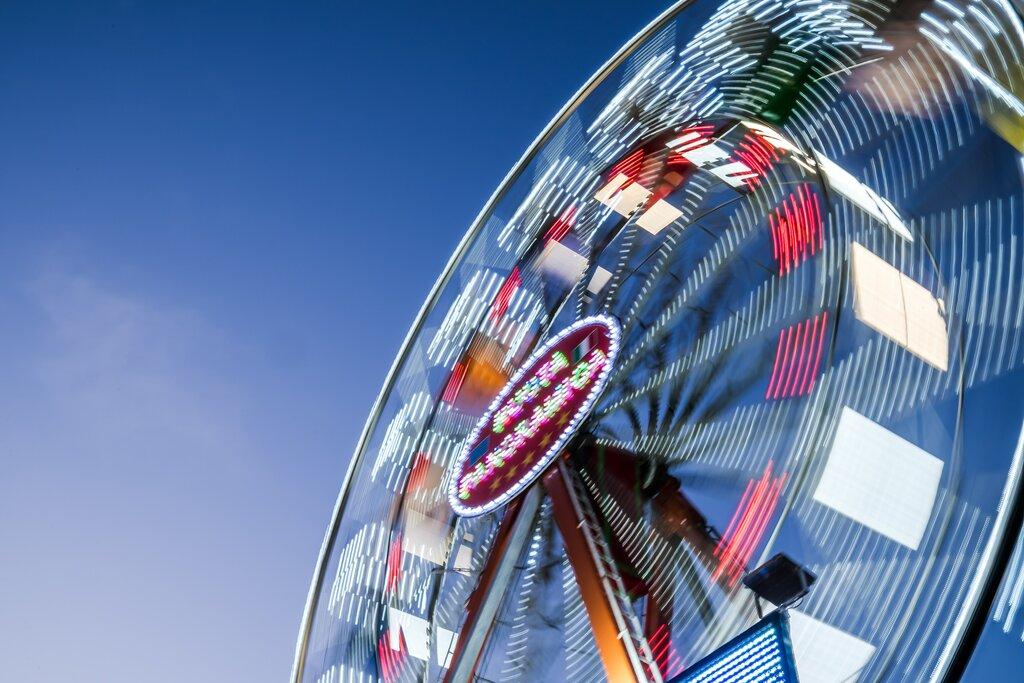 Ferris wheel on Lake Garda [Photo by Luca Ambrosi on Unsplash]