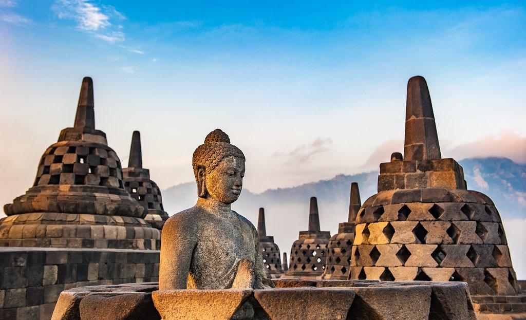 Wander around the iconic stupas at Borobudur