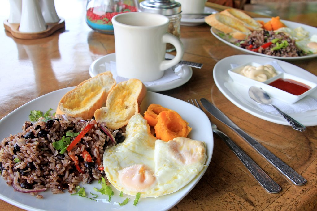 A traditional Costa Rican breakfast with gallo pinto, eggs, and coffee