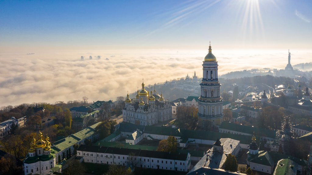 Aerial view of the Monument Motherland, shrouded in thick fog at dawn, Kiev, Ukraine