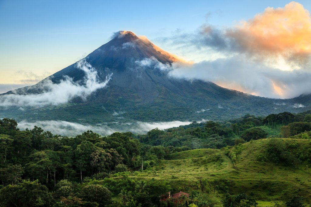 Scenic view of Arenal Volcano and the rainforest that stretches before it.