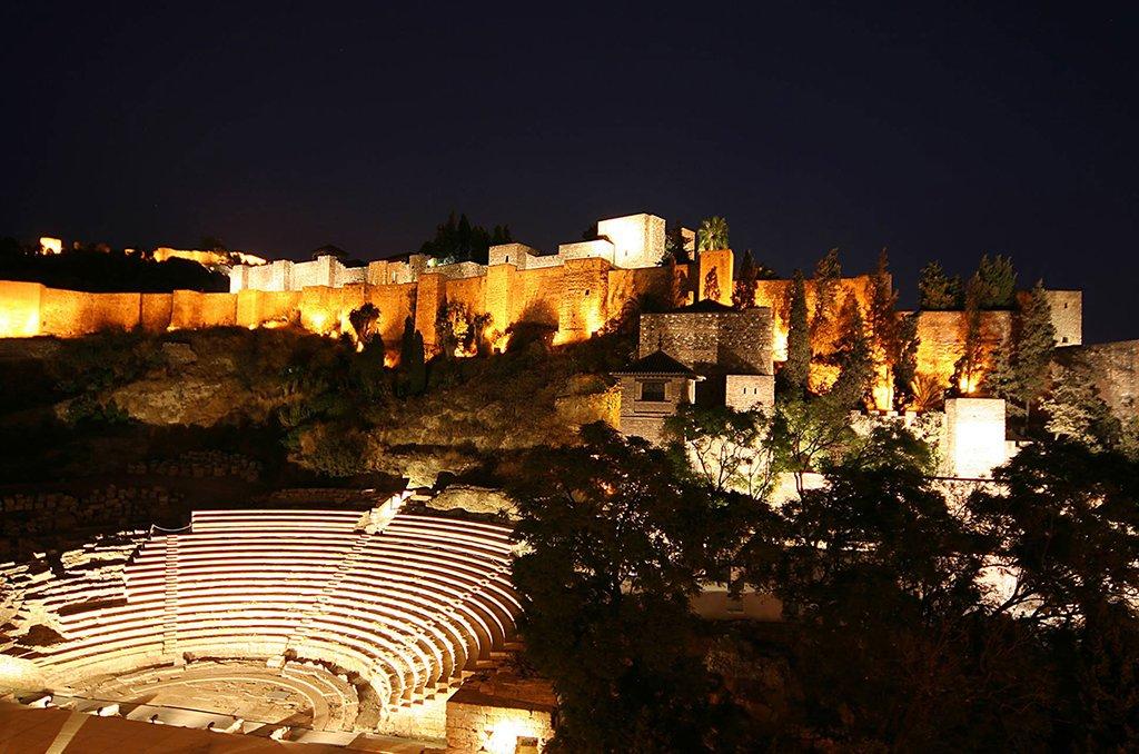 Night falls over Málaga's Alcazaba.
