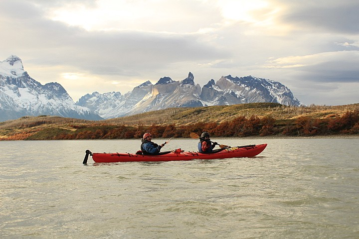 Kayaking against magnificent mountain scenery.