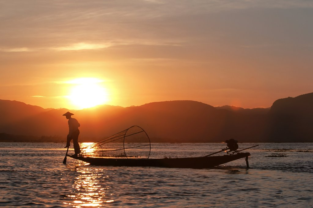 Fisherman silhouette at the sunset on the Inle Lake, Myanmar