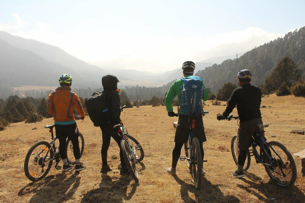 Cyclists in the Phobjikha Valley, Bhutan