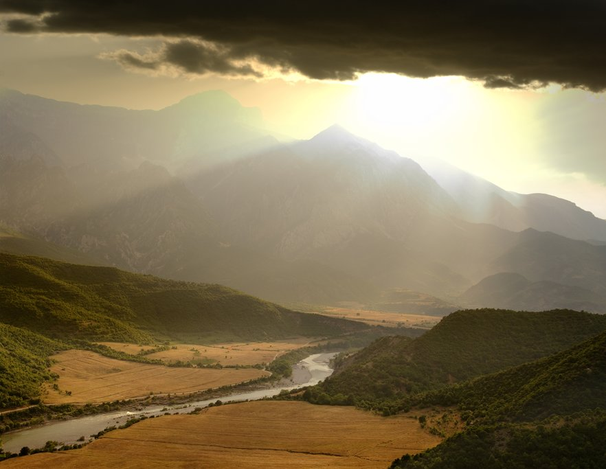 A dramatic sky illuminates the Vjosa River