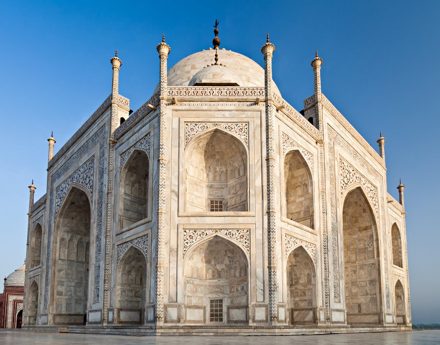 Visit the Taj Mahal at sunrise and see the white marble change color with the light