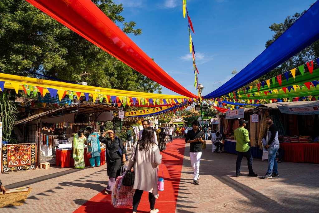Take a taxi to Dilli Haat, an outdoor craft market bazaar