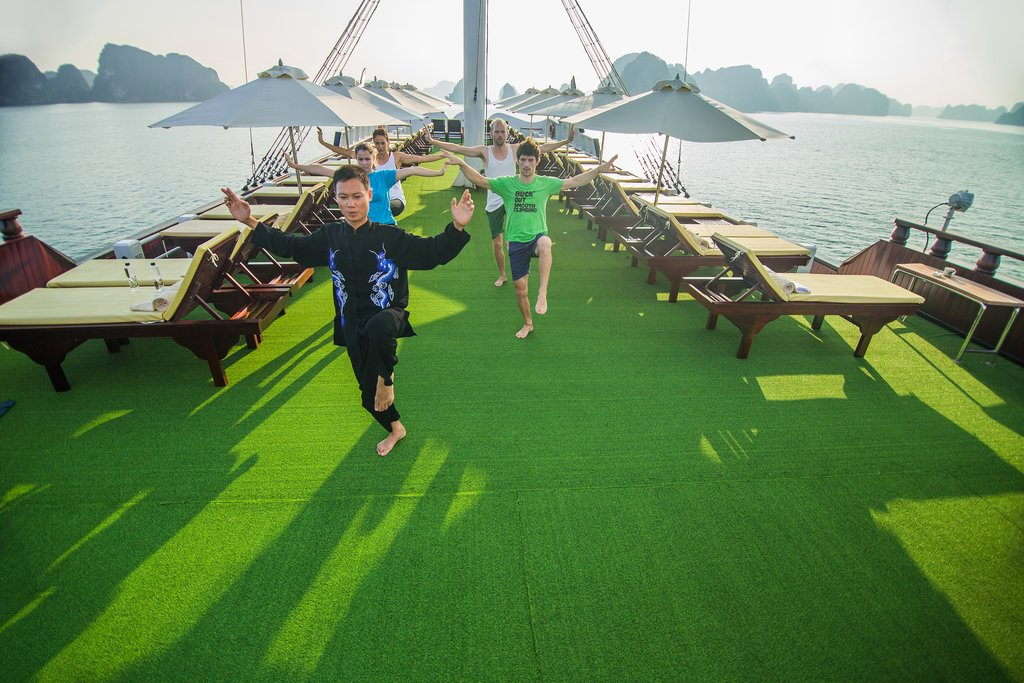 Partake in morning exercise or a swim at the beach in Ha Long Bay