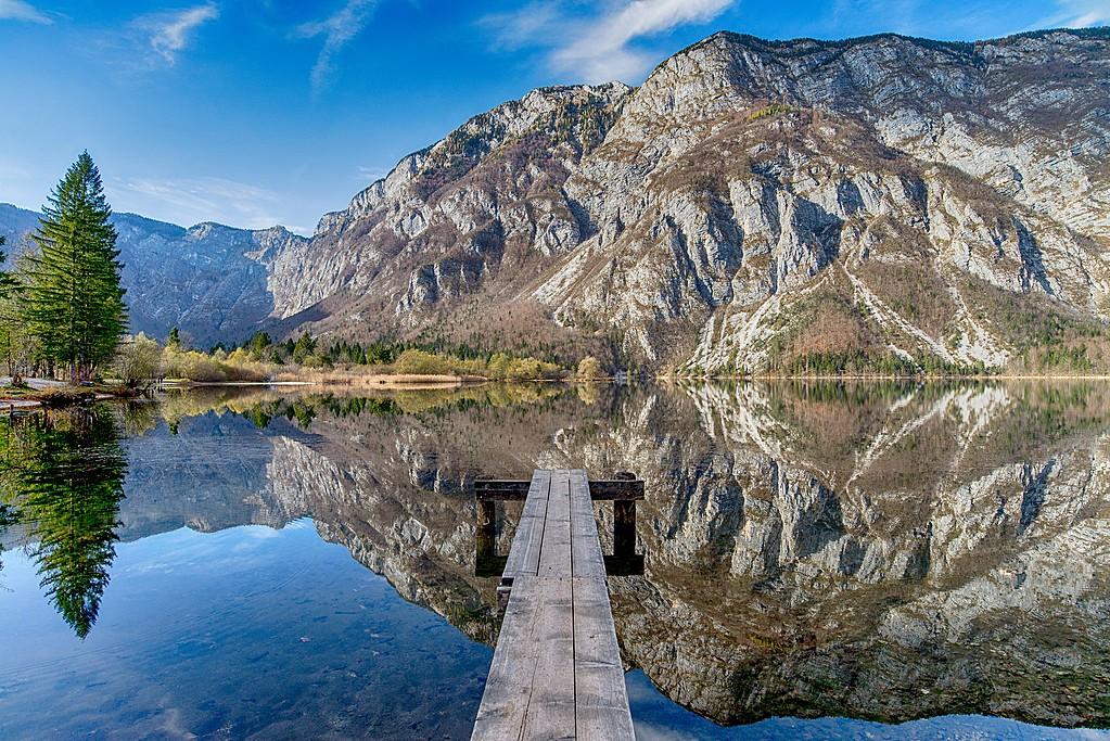 Jump off a dock in Lake Bohinj