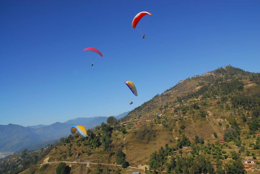 Paragliders descending from Sarangkot Hill