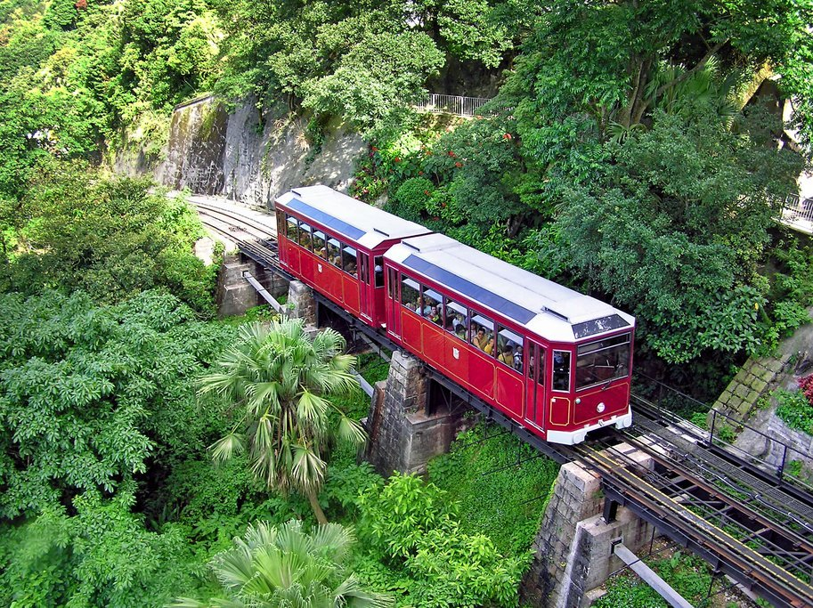 A tram whisks travelers 1,811 feet (552 m) to the top of The Peak
