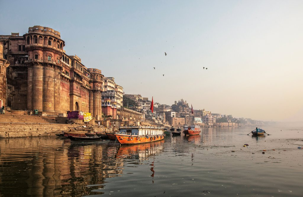 Go on a sunrise boat trip along the Ganges