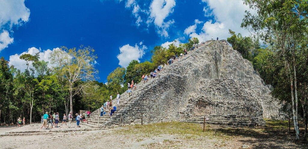 Tourists climb the Nohoch Mul pyramid