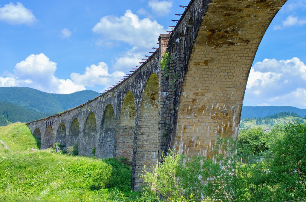 Railway viaduct old bridge on a background of mountains