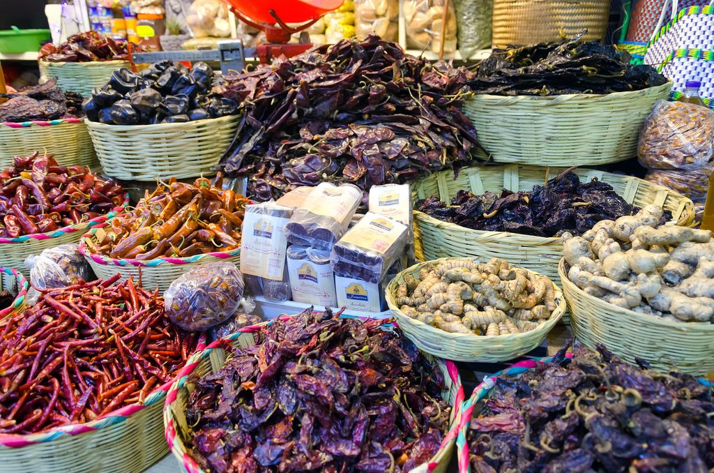 Chili peppers and chocolate for sale in a marketplace in Oaxaca