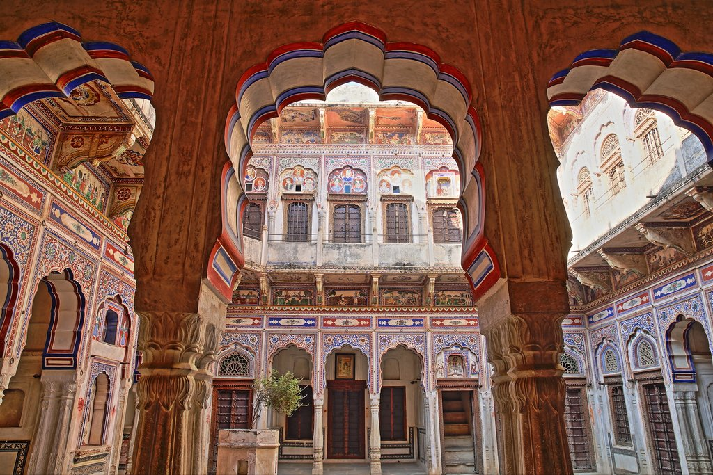 India - Shekhawati RAJASTHAN - Morarka Haveli with colorful frescoes and paintings and arcades in the foreground