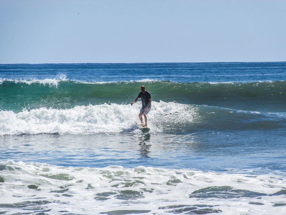 Take a surfing lesson on Domincal Beach