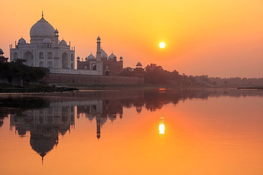 Head to the river at sunset to capture your first glimpse of the Taj Mahal