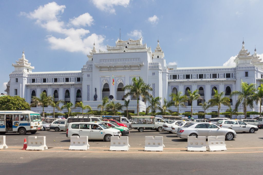 Save Download Preview Yangon, Myanmar-May 8th 2014: Traffic moving past Yangon City Hall. It was built between 1925 and 1940.