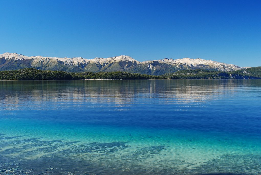 Take a boat ride on the vivid blue waters of Lago Nahuel Huapi