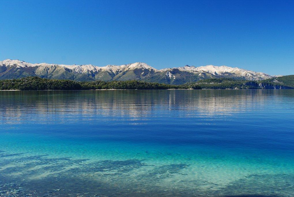 Take a boat ride on the vivid blue waters of Lago Nahuel Huapi