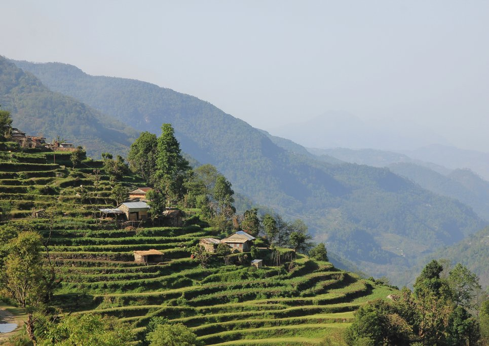 Tiered hillside and traditional structures on the way to Landruk