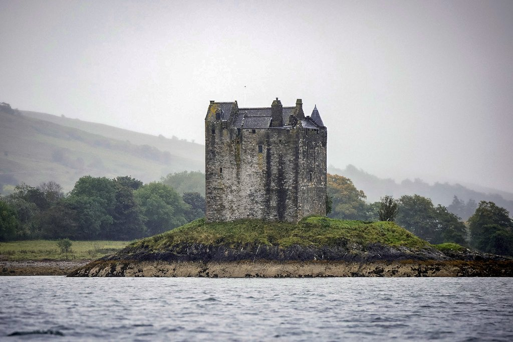 Castle Stalker guarding its own private island.