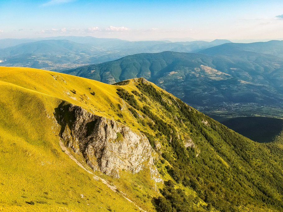 A myriad of greens, blues, and yellows surrounding Travnik