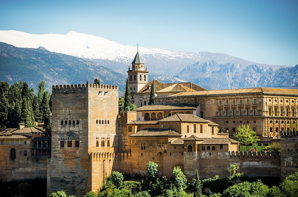The snow-capped Sierra Nevada Mountains overlooking the Alhambra.