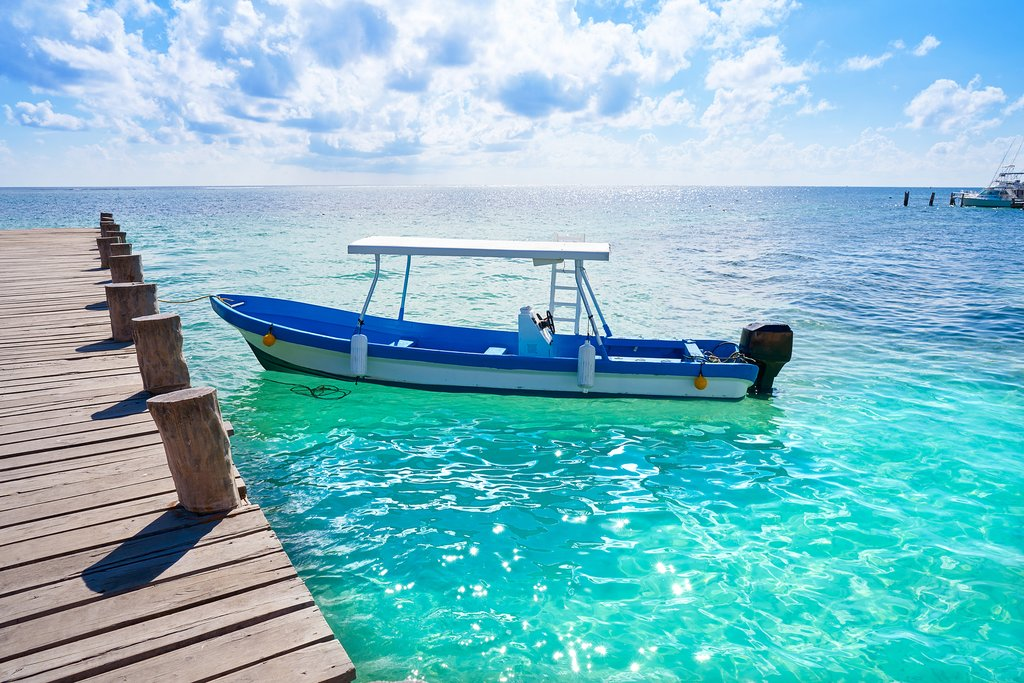 A boat transports passengers to the coral reef  in Puerto Morelos