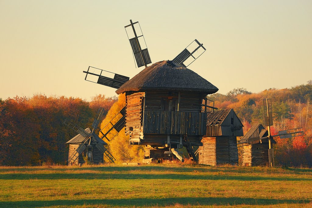 Ukraine - Traditional ukrainian windmill in the museum of national architecture in Pirohiv in a beautiful autumn day before sunset