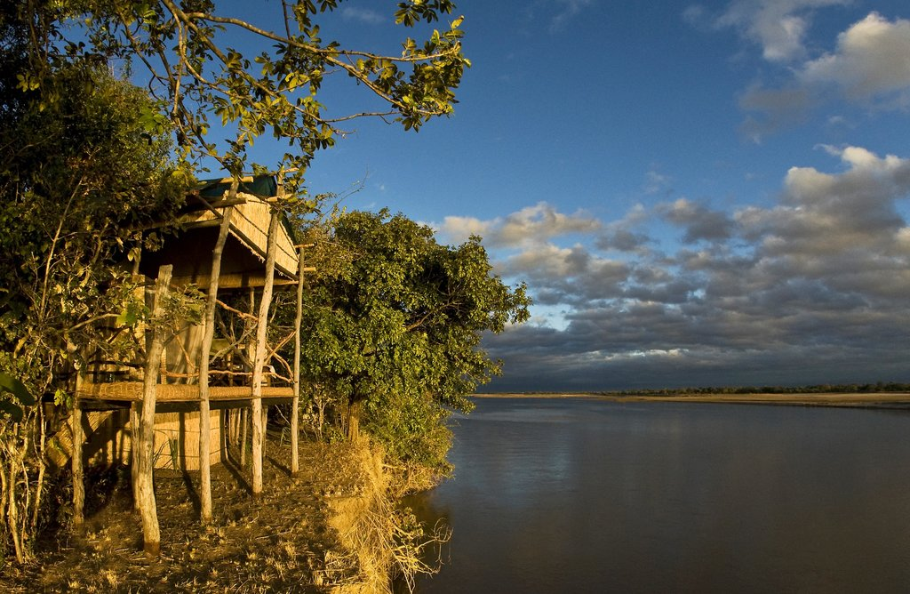 View of Island Bush Camp with an open room facing the river