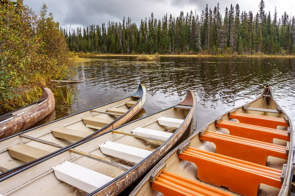 Canoes moored in McGillivray Lake in the Shuswap Highlands