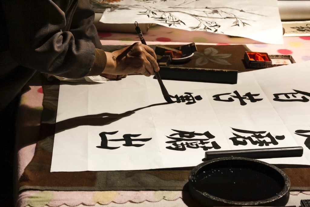 Practicing Shodo calligraphy in Kyoto.