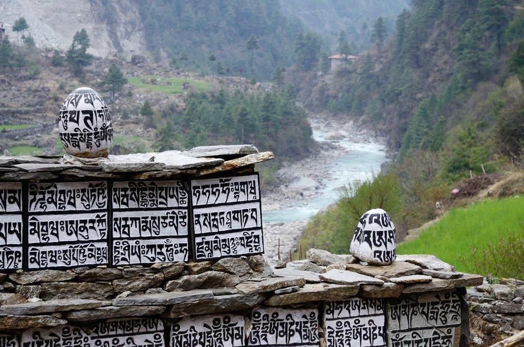 Buddhist mani stones with sacred mantras near Dudh Kosi river,Eastern Nepal, Everest region