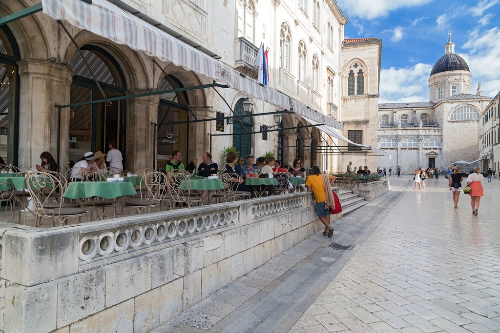 Café in Old Town and the Assumption Cathedral