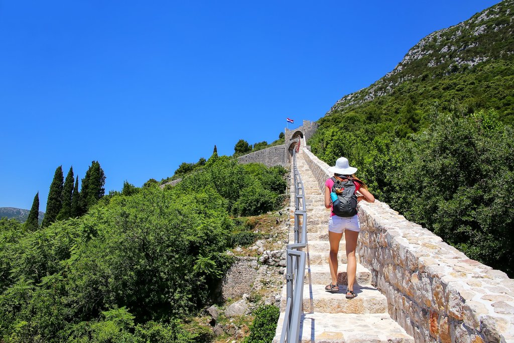 Climbing the parapet walkway of Ston's defensive wall