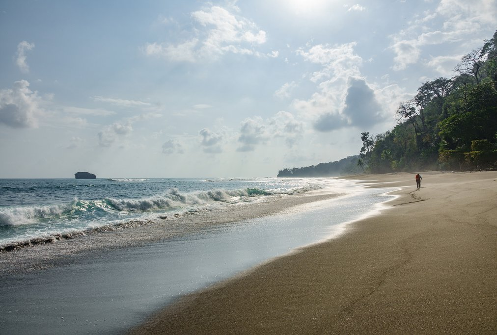 Take a sunrise beach walk before your flight