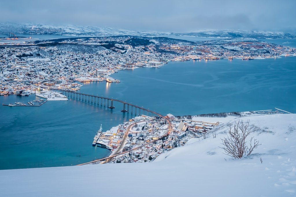 An aerial view of Tromsø from the mountain ledge
