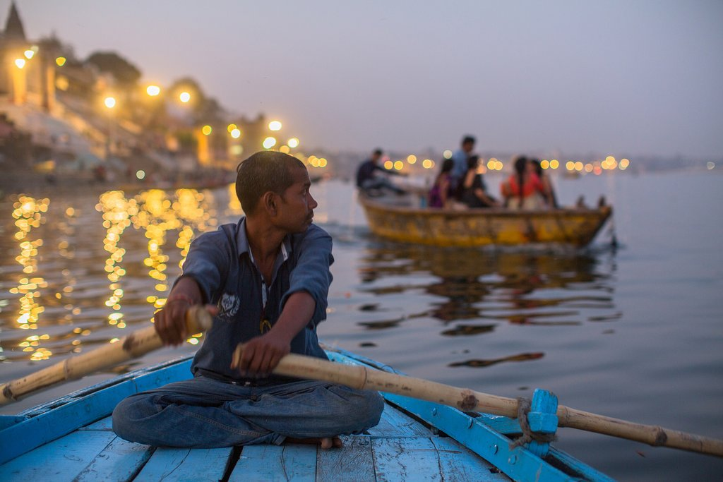 Witness devotees performing rituals on the banks of the Ganges at sunset