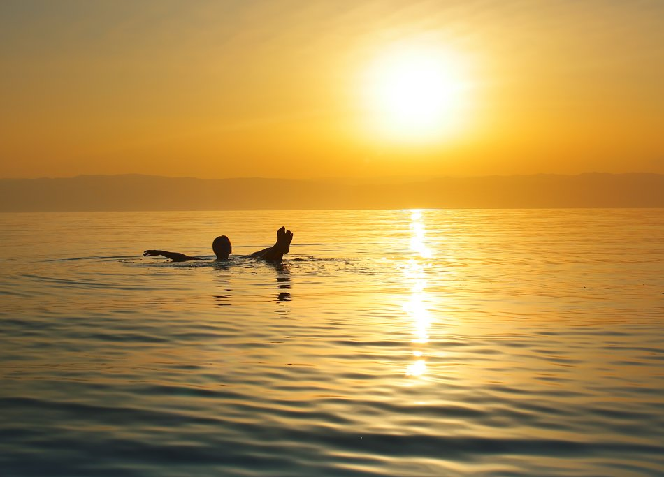 Swimmer floating on the Dead Sea