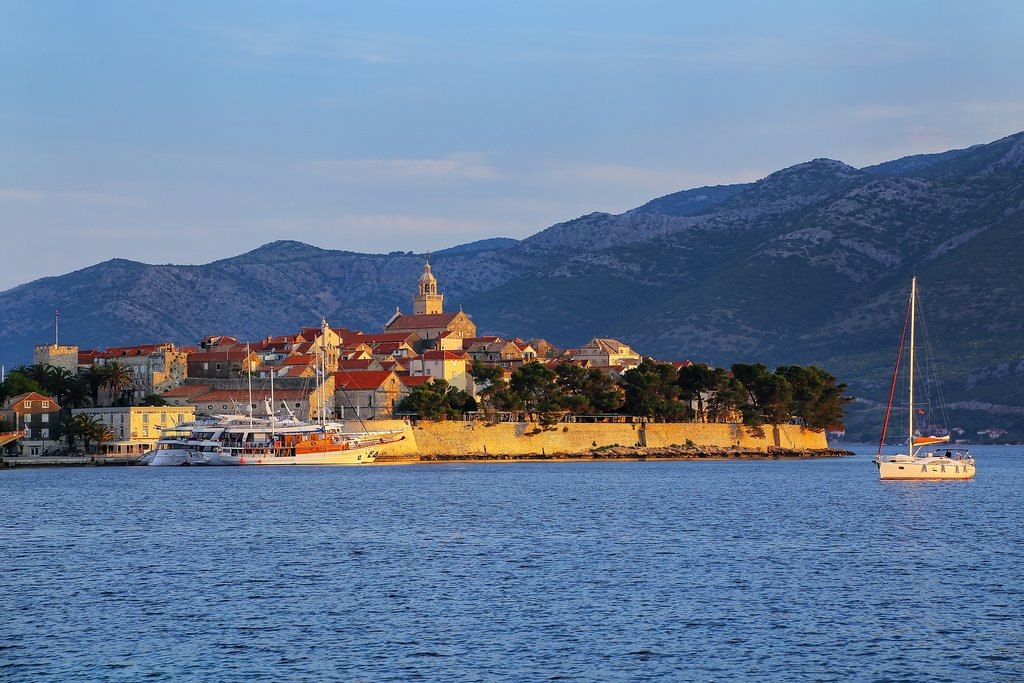 Sailboat at dusk in Korcula's harbor