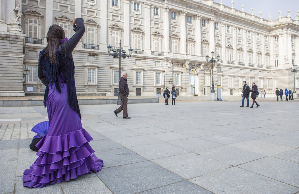 A flamenco  dancer outside Madrid's Royal Palace